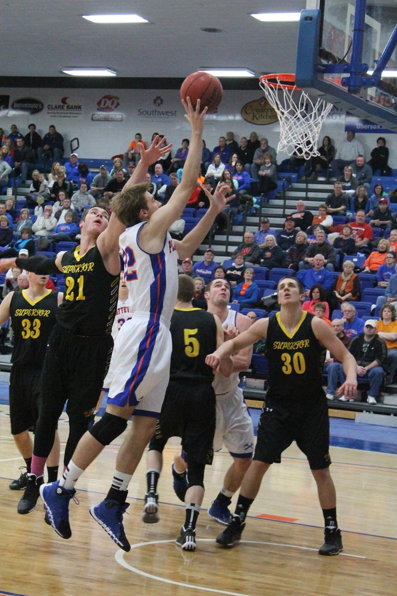 Junior Jim Stocki lays the ball up for 2 of his 17 points in WIAC home game against UW-Superior Jan. 25.