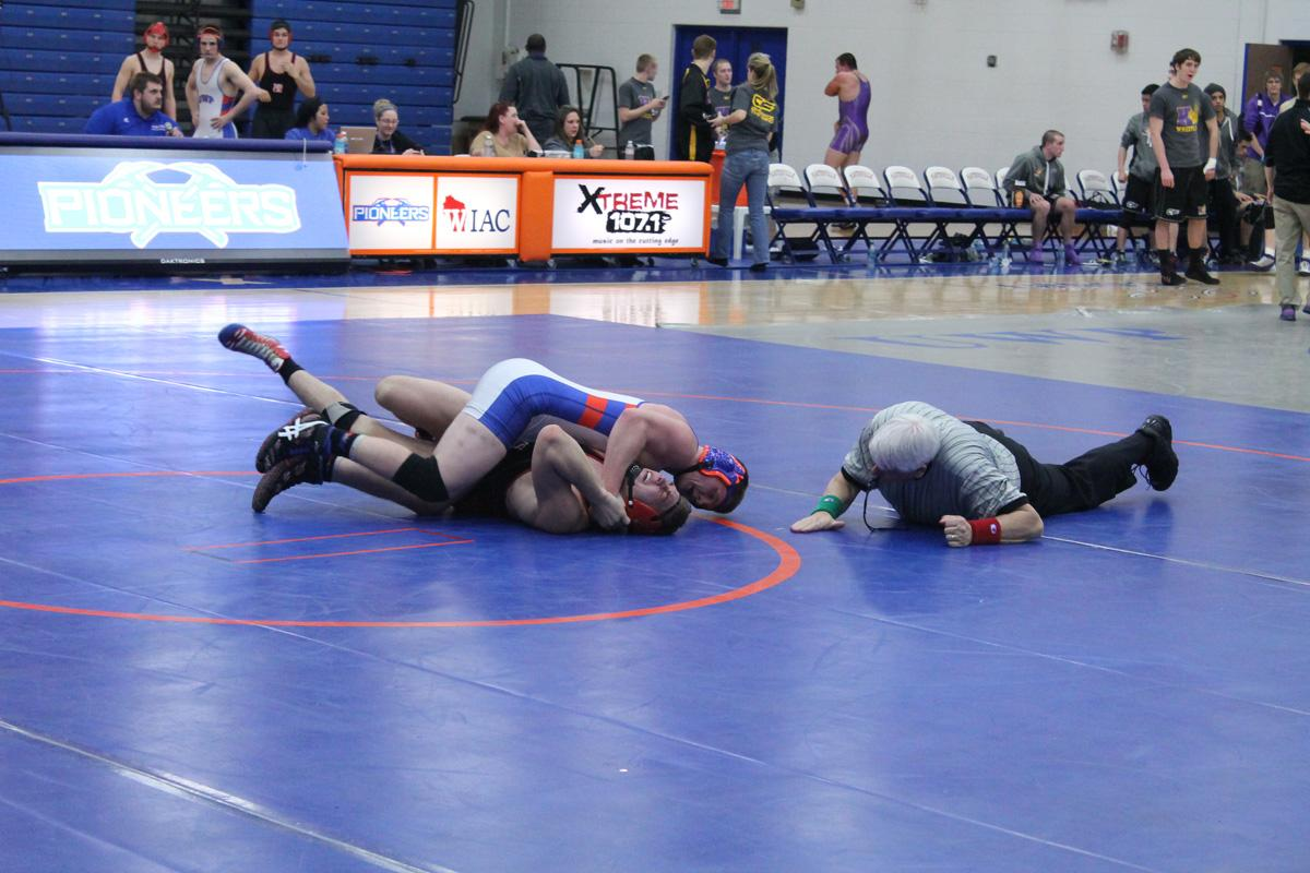 Sophomore Dylan Deshane pins his opponent from MSOE at UW-Platteville Quad.