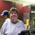 Huehne smiles from behind the register at Hickory & Main, where she has served many students and faculty.