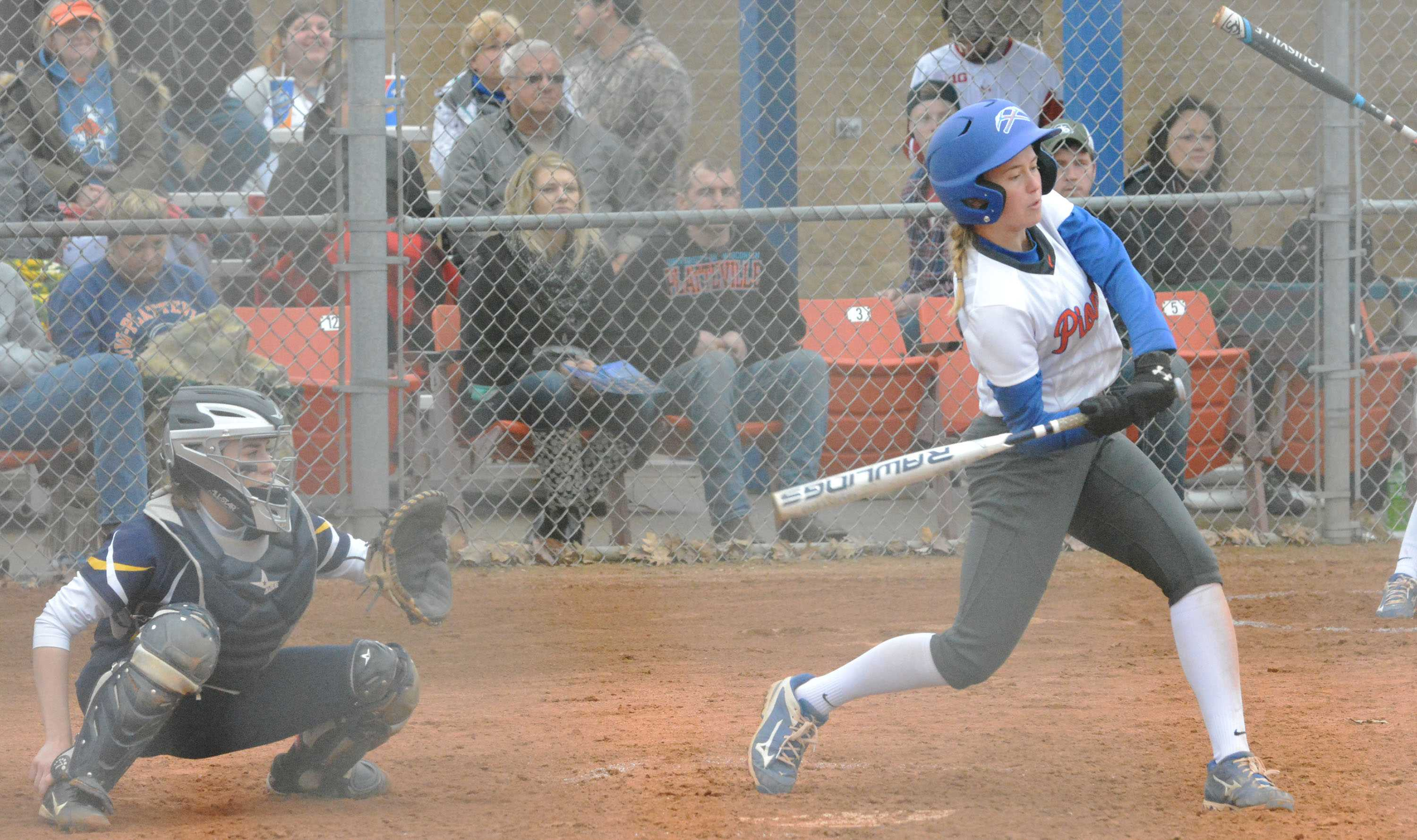 UW-Platteville softball player takes a swing against Beloit College while another teammate prepares behind her.