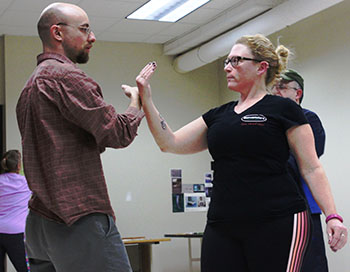 "Professor Thomas Pitcher teaches  class participant tai chi move  ""Push Hands"" during their class on Monday evening"