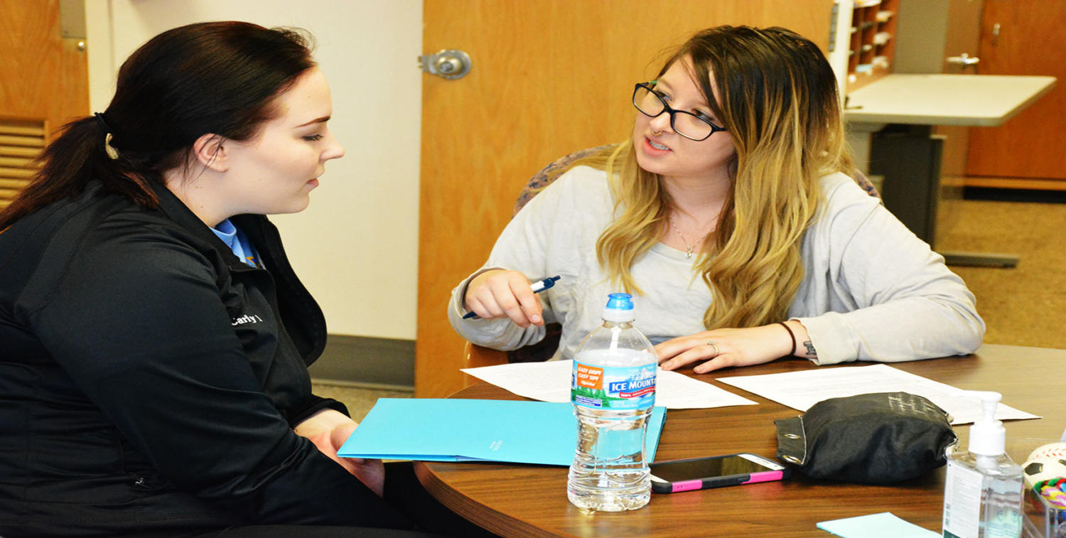 Senior professional writing major BriAnna Bruce assists junior biology major Carly Muller with the revision process. If you need assistance contact the Writing Center.