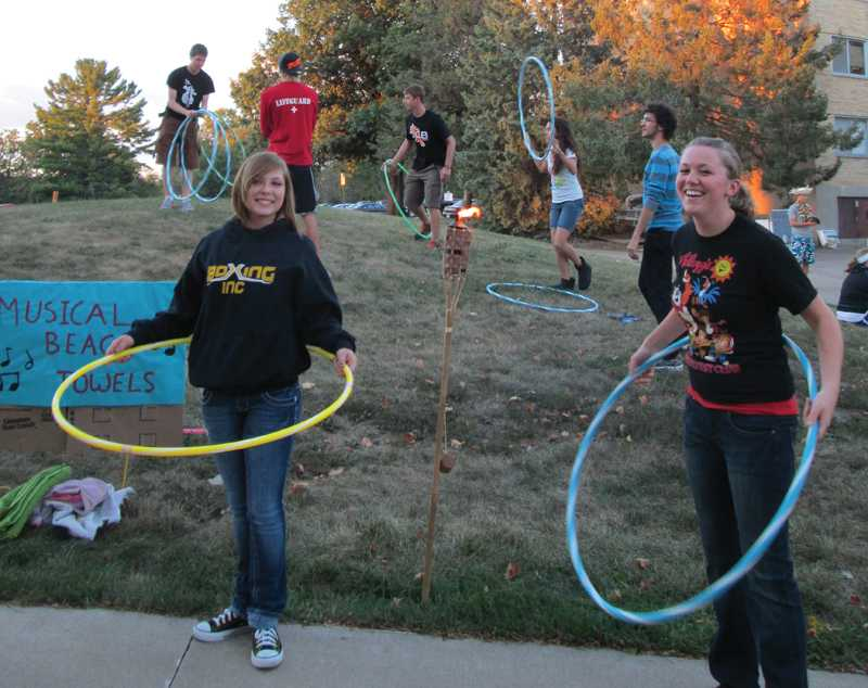 Brittany Tuskey, sophomore criminal justice major and forensics investigation major (left) and Amber Slovik, junior enginering major, (right) hula-hooping to music