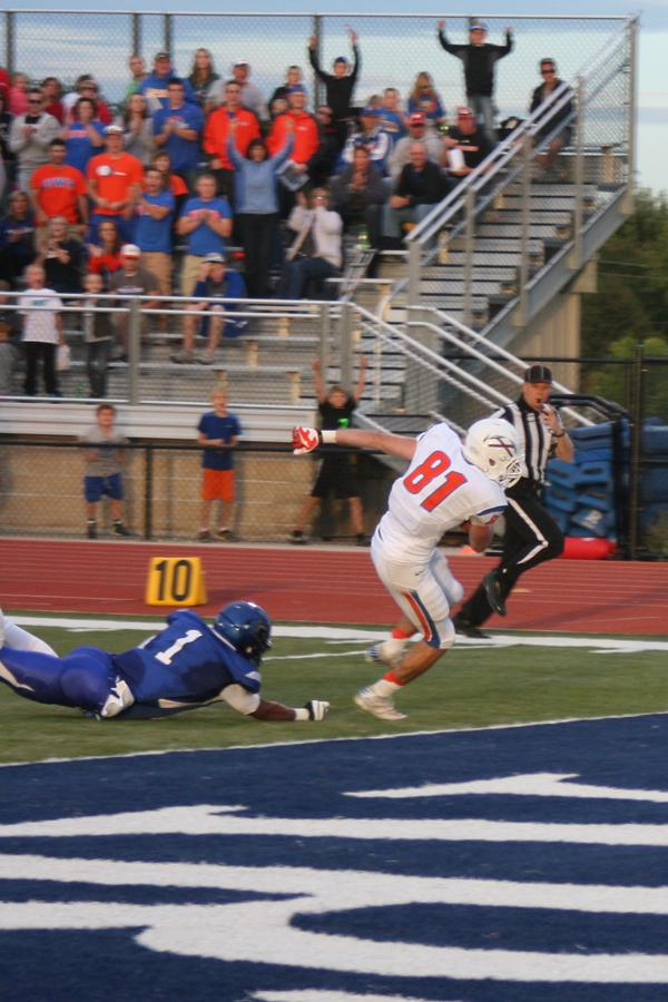 Junior receiver Trevor Whitehead (81) breaks a tackle and gets into endzone on Sept. 14 against Dubuque. Whitehead caught two scores at Lewis and Clark, giving him four touchdown receptions on the season.