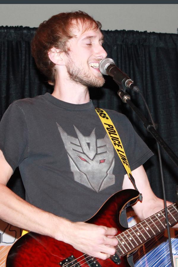 Lindsey Deibner, alumni of UW-Platteville, sings during his set at Open Mic Night Sept. 17.