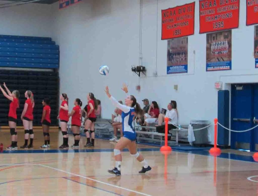 Andrea Larsen (5) serves an ace in a loss against Carroll College Sept. 6.