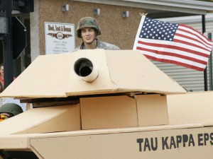 Nick Nommensen, member of Tau Kappa Epsilon, sat in the turret of the fraternity's tank float during the Homecoming Parade Saturday morning. Tau Kappa Epsilon's theme honored soldiers.
