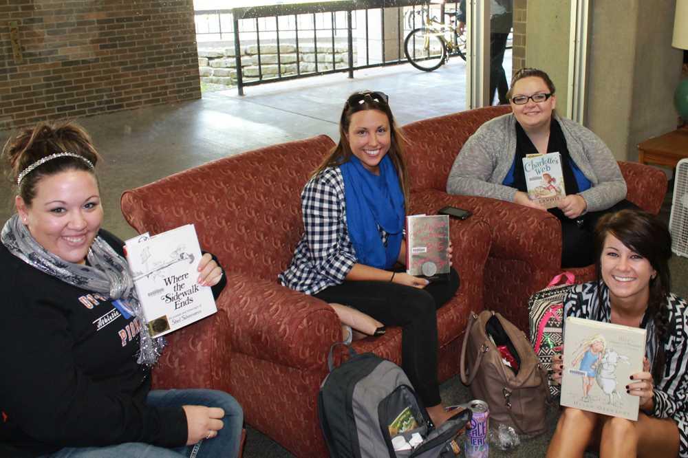 Cassie Heusinkveld, Monica Zapp, Kaela Shipley and Allie Gaar proudly display their favorite banned books.