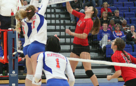 Senior Stephanie Kirchner and junior LeeAnn Mizgalski team up for a block in the second set against University of Wisconsin-River Falls. The Pioneers tallied 59 blocks in two games last week.