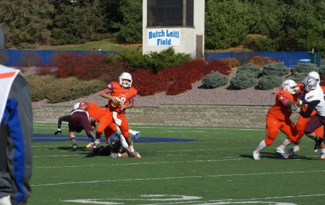 Senior quarterback John Kelly avoids a third-quarter sack against UW-La Crosse Nov. 9. Kelly helped the Pioneers secure their eighth win of the season with 250 yards and a touchdown.