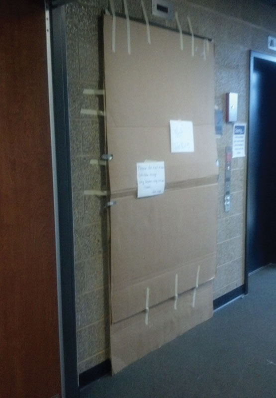 """The elevator in Southwest Hall was closed and boarded with cardboard on Nov. 10.  The sign posted read, """"Please do not even consider using! Very broken, very unsafe. Thanks!"""" -SWH Staff"""