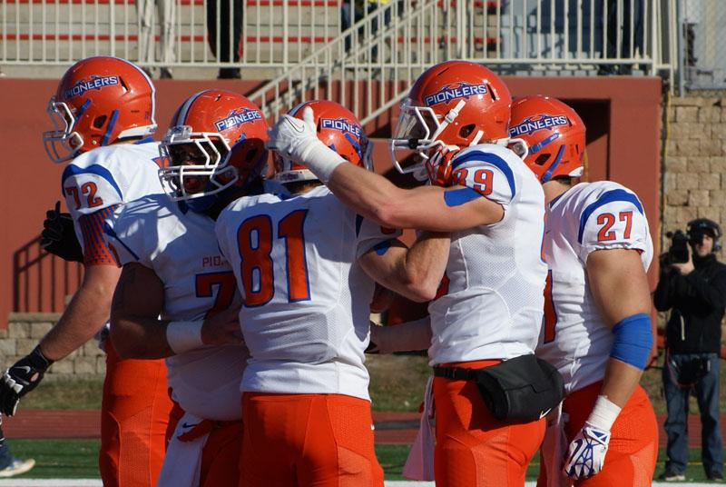 Six Pioneer players celebrate a touchdown in the second quarter of their playoff game against North Central Nov. 30