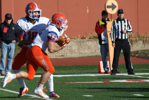 Sr. QB John Kelly (18) hands off to Jr. RB Andy Puccini (32).