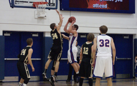 Junior forward Jake Manning (34) is fouled on a layup in the first half against St. Olaf Nov. 24. The Pioneers lost the game 68-62, after scoring just 22 points in the second half. As of Tuesday, the Pioneers are 4-2 on the season.