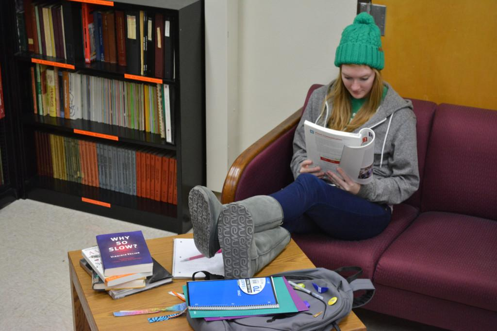 Sophomore media studies major Anna Strand studies homework in the Women's Advancement Center at 100 Russell Hall, a lounge that was opened to the student body this semester.