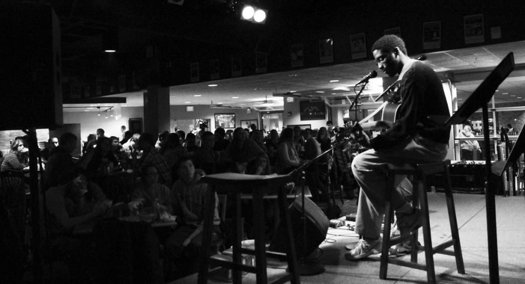Freshman general engineering major David Ababio serenades the crowd at Open Mic Night. It was a standing-room only crowd, as Saturday marked the last Open Mic Night of the semester
