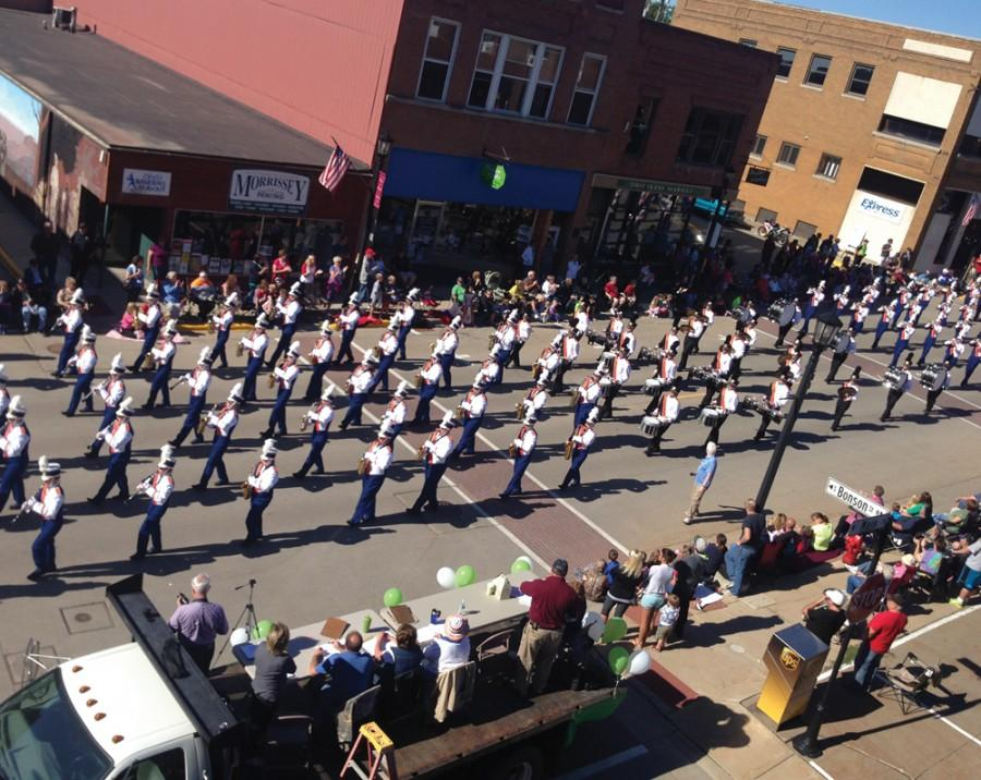 The University of Wisconsin-Platteville Marching Pioneers step to the beat of their own drums as they entertain parade-goers on Main Street.