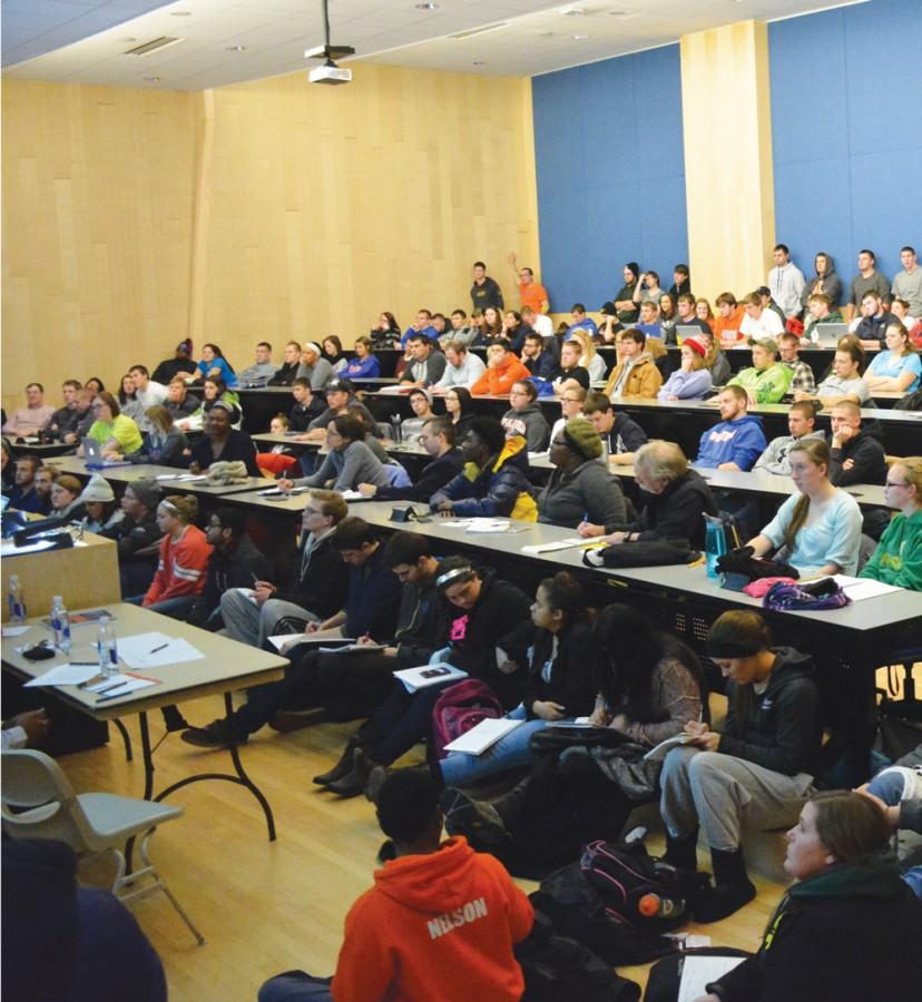 Students gather in Doudna 136 to listen to professors speak about the recent Ferguson, Mo. shooting.
