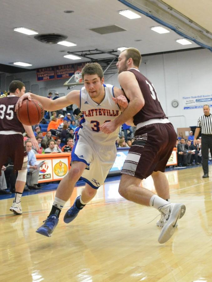 Senior forward Jake Manning dribbles past a UW-La Crosse defender at the Feb. 18 final regular season home game. Manning contributed a game-high 25 points as the Pioneers routed the Eagles 64-61 to earn a first round home game in the WIAC tournament.