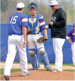 Head coach Eric Frese brings in sophomore pitcher Kale Pustina. The Pioneers went through six different pitchers in their first loss of the second doubleheader to the Pointers on April 19, 19-6.