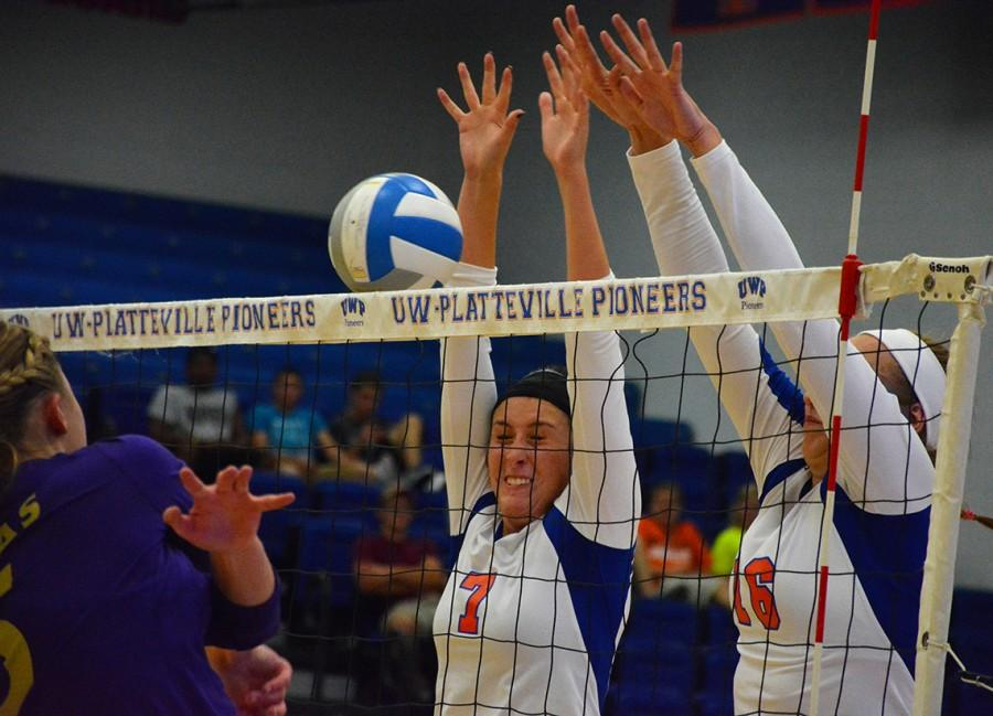 Juniors Lidia Frias and Rachel Ambroch attempt to block a kill form a Duhawk opponent at the Sept.9 home game.