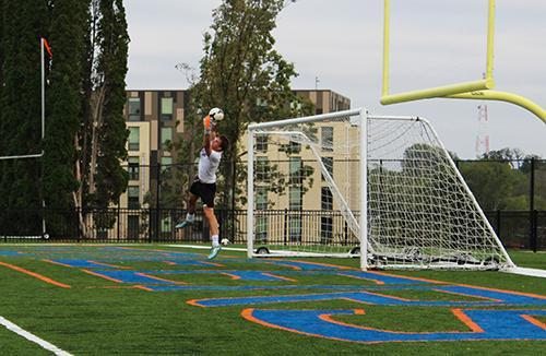 Scott Sibik blocking a goal during soccer practice.