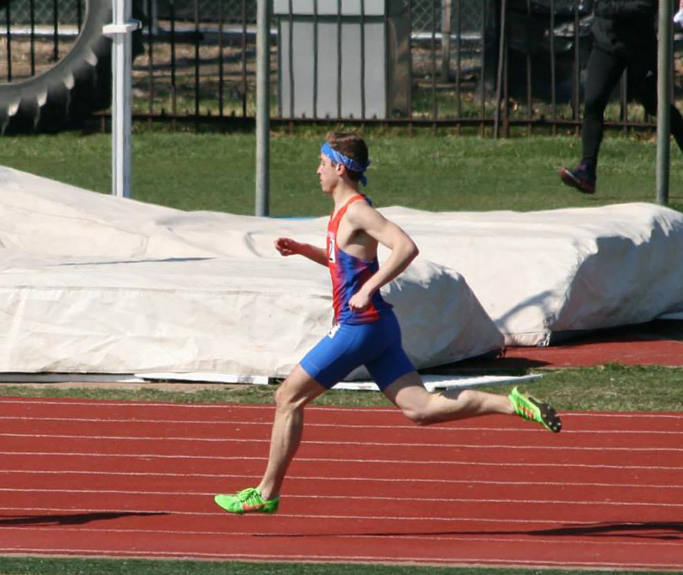 Arther running in a meet at Washington University.