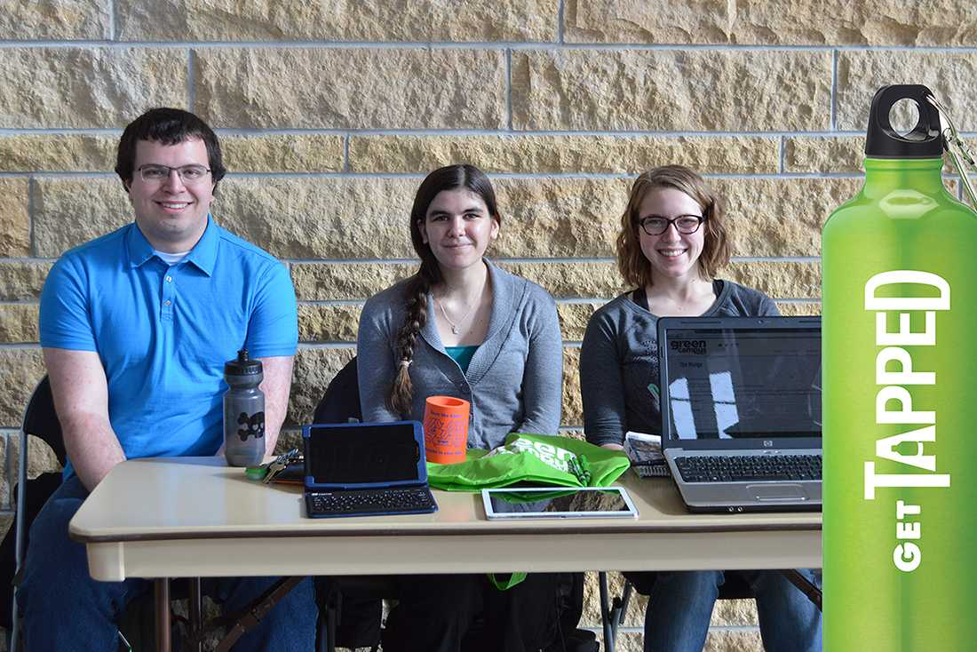 Matt Lindberg, senior sustainable renewable energy systems major, Valeries McGoldrick, freshman soil and crop science major and Andrea Wenzel, senior animal science major work at getting pledges at the Markee Pioneer Student Center. Green Campus Project promotes reusable water bottles.