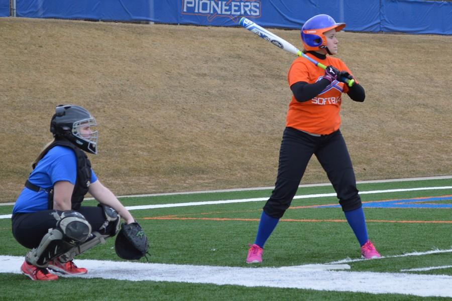Freshman+catcher+and+undecided+major+Courtney+Stephens+and+sophomore+second+base+fielder+and+forensic+investigation+major+Clarie+Baumgartner+practice+with+their+team+on+the+football+field+while+the+softball+diamond+is+still+wet.