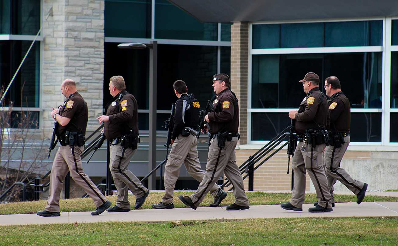 Grant County Sheriff's Department patrol the University of Wisconsin-Platteville campus after reports of a firmarm in Ullsvik Hall. All buildings were evacuated after the 1:30 p.m. announcement.