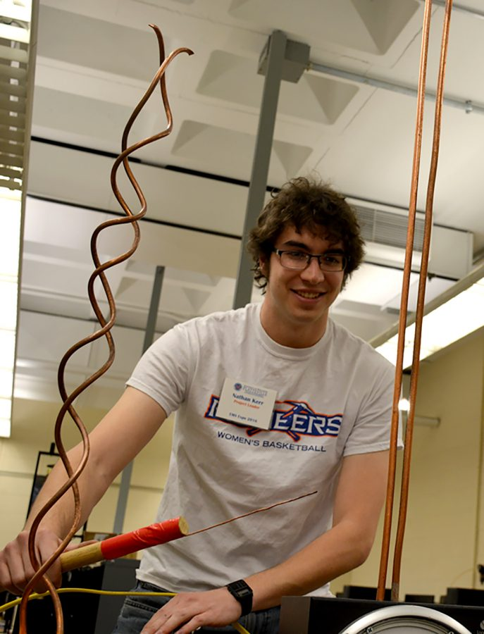 Nathan Kerr helps out at the Engineering Expo, which showed local students all about the STEM field.