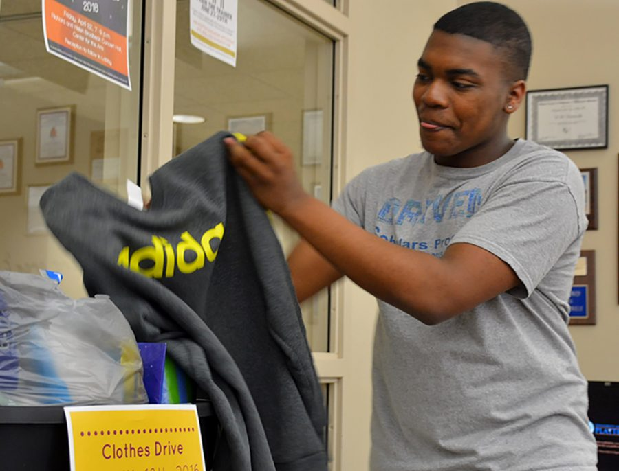 Justin Toney, junior media studies major donates clothes to Black Student Union's clothig drive. The drive is going on until April 18, when the clothes will be donated to Orion Family Services.