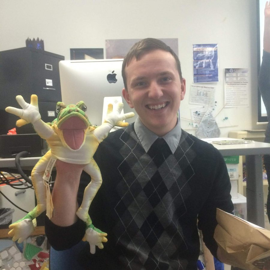 Senior elementary education major Peter Wilkinson shows off a hand puppet he uses for one of his teaching courses.