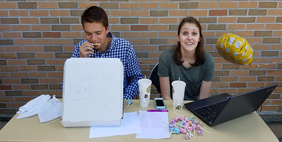 Sophomore mechanical engineer major, Brent Strand and sophomore industrial engineer major, Rebecca Koble work their booth at the Fall 2016 service fair. Strand and Koble were there representing the Pioneer Food Pantry organization. The Pioneer Food Pantry organization was established last year, and the organization is currently looking for a faculty adviser.