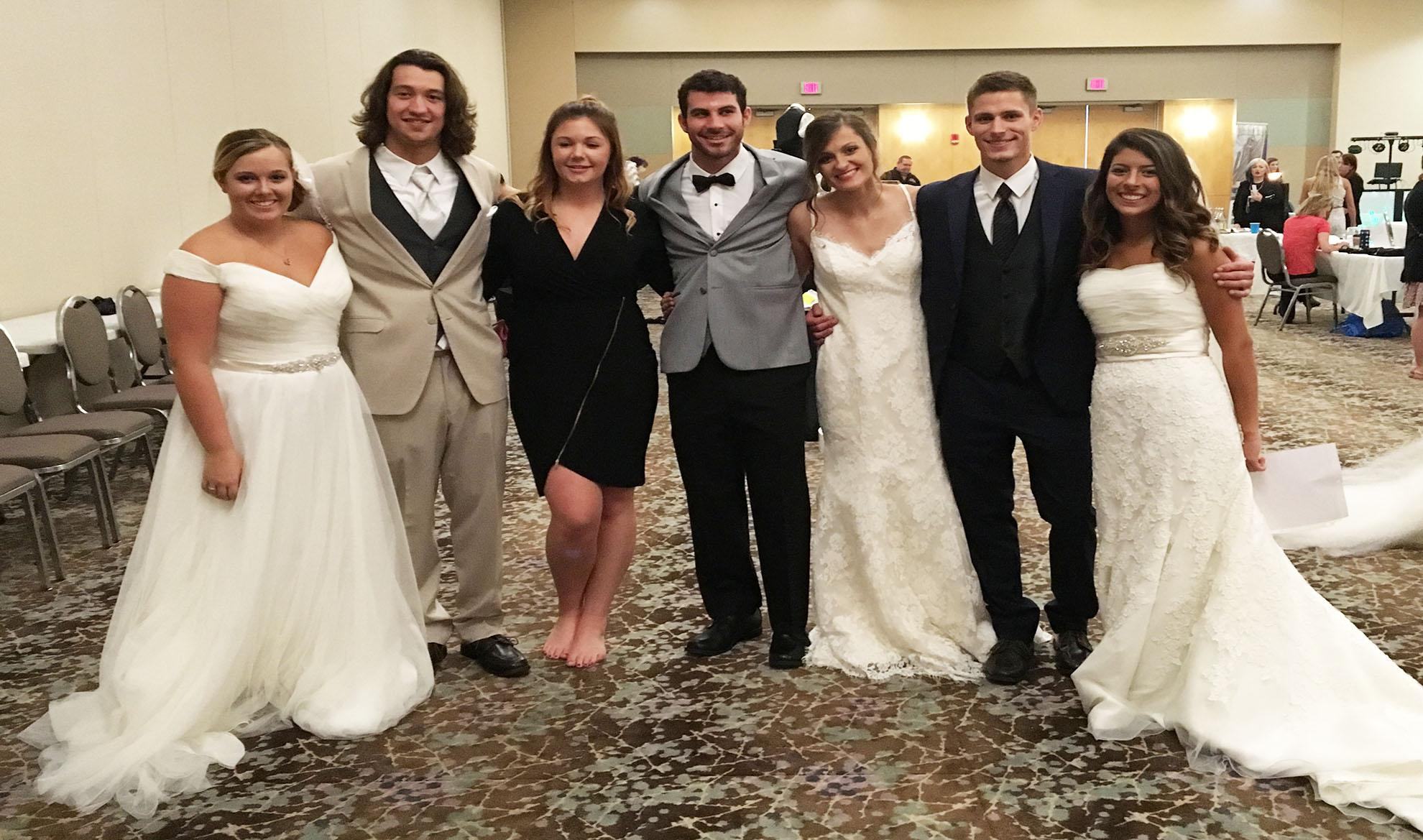 Platteville men and women show off a variety of designer tuxedos and wedding dresses in Zazou's Bridal show.