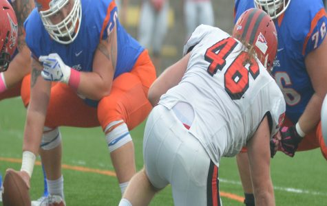 UW-Platteville Pioneer football players junior Ryan Gaul and freshman Nick Broadhurst set up on the offensive line during the homecoming game against the UW-River Falls Falcons.