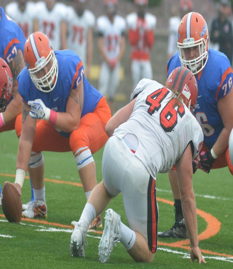 UW-Platteville+Pioneer+football+players+junior+Ryan+Gaul+and+freshman+Nick+Broadhurst+set+up+on+the+offensive+line+during+the+homecoming+game+against+the+UW-River+Falls+Falcons.