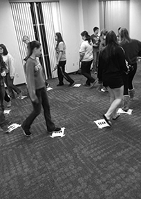 Students play a musical chairs -esque for Family Advocates fundraising event.