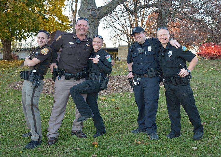 Officers pose for a photo during Run with the Cops 5k run/walk 2016.