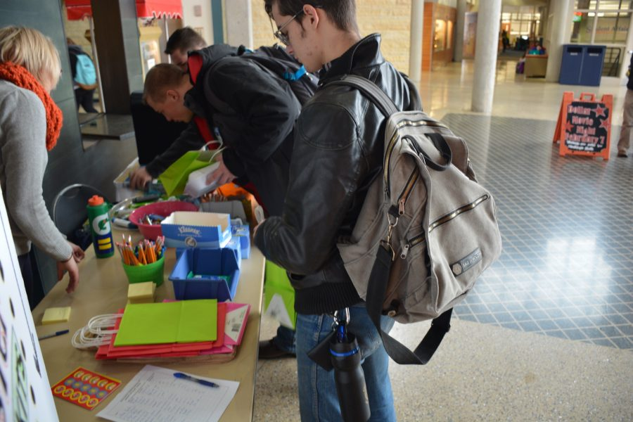 Students enjoy filling survival kits with free school supplies thanks to the Doyle Center's new event.