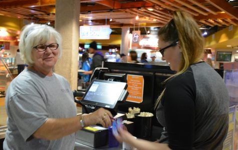 Pioneers feel welcomed when they go through Brenda Donar's lunch line at the Pioneer Crossing. Donar is being honored with the National Residence Hall Honorary award.