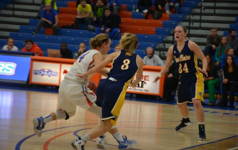 Senior industrial engineering and business administration major Morgan Hartman takes on the Eau Claire defense on her home court during the Jan. 25 game.
