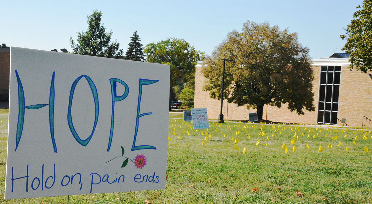 University Counseling Services displays 1,100 yellow flags for suicide awareness.
