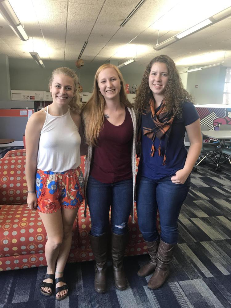Maya Kramer, Becky Holmquest and Jacqueline LeFevre pose after receiving reward.