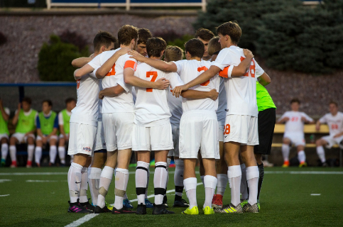 The men's soccer team comes together for a group huddle during the NCAA Division III tournament.