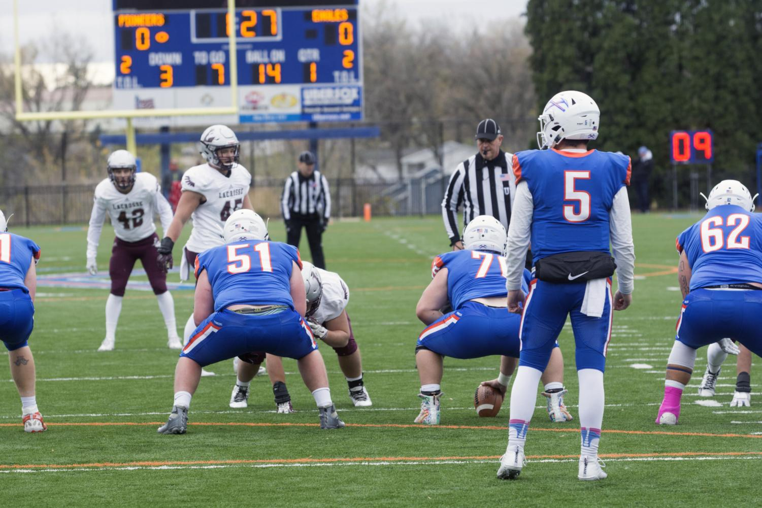 The Pioneers drove downfield in the first quarter of the game against  the Eagles.