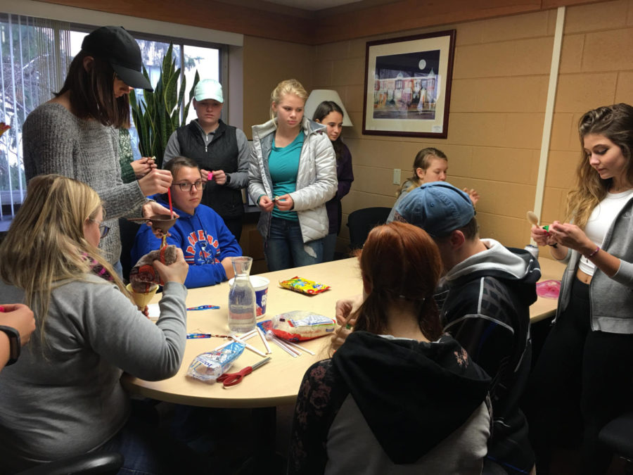 Attendees at Wellness Tuesday last week help one another make stress balls.