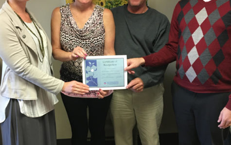 Terry and Patti Cullen receive the Mental Health Matters Award from University Counseling Services.