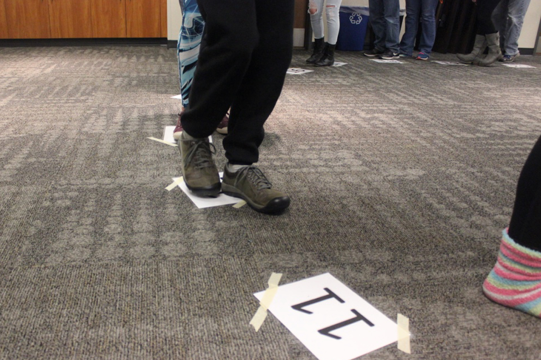 A participant looks to take a chance on a different number to win baked goods.