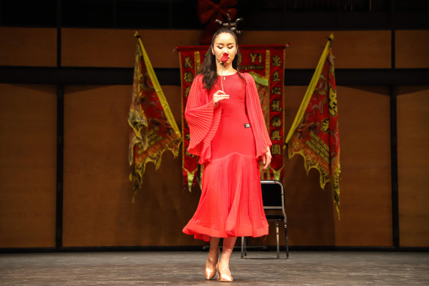 Dr. Alice Han performing a ballroom dance on stage.